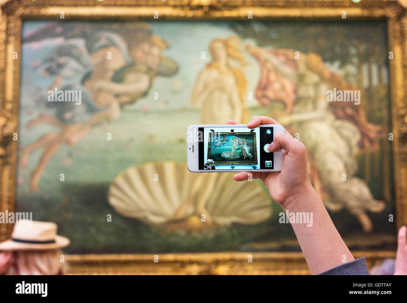 The Birth of Venus by Sandro Bottichelli in Florence's Uffizi Gallery seen through a smartphone screen. - Stock Image