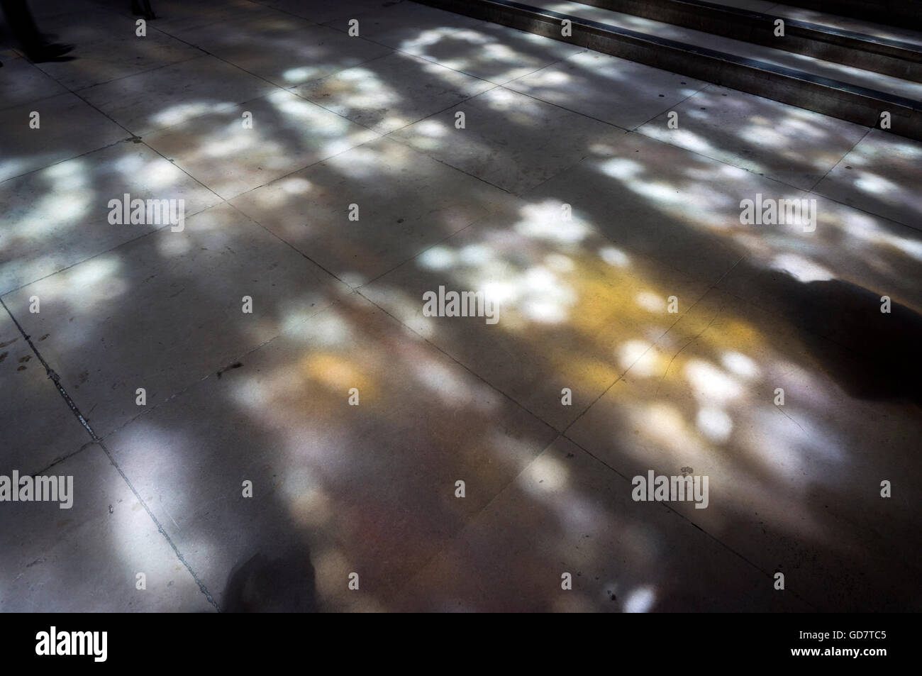 Dappled light passing through stained glass on to the floor of St. Stephen's Porch at the Palace of Westminster, - Stock Image