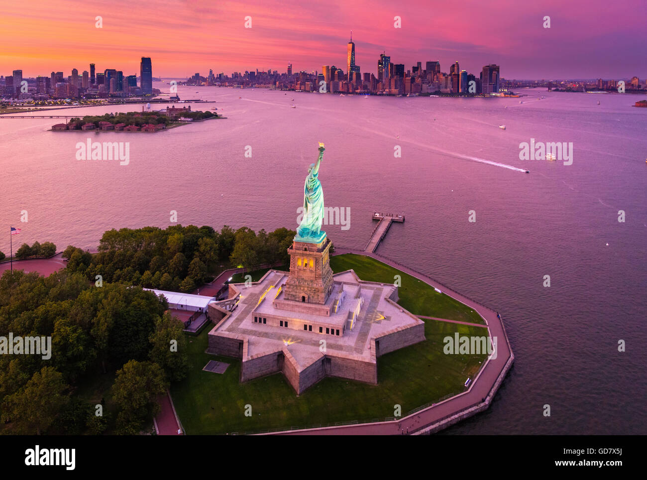 The Statue of Liberty is a colossal neoclassical sculpture on Liberty Island in New York Harbor in New York City - Stock Image