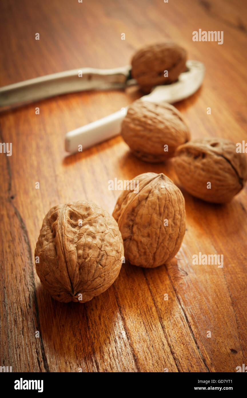 walnuts on a table with nutcracker - Stock Image