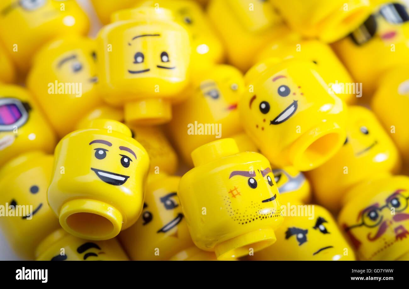 A selection of Lego Mini figure heads - Stock Image