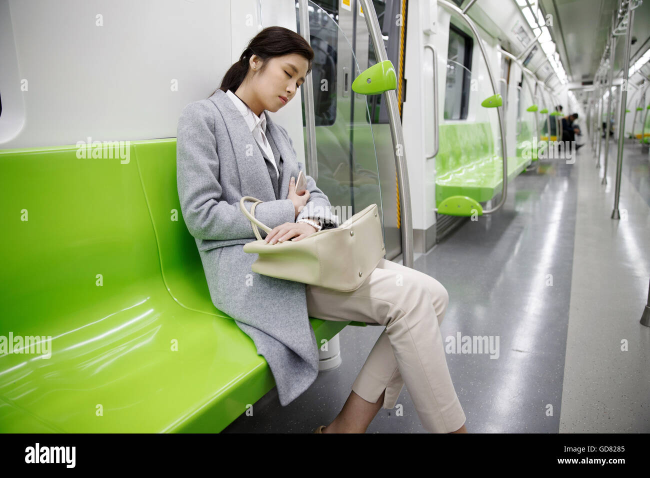 Tired of young women to rest on the subway - Stock Image