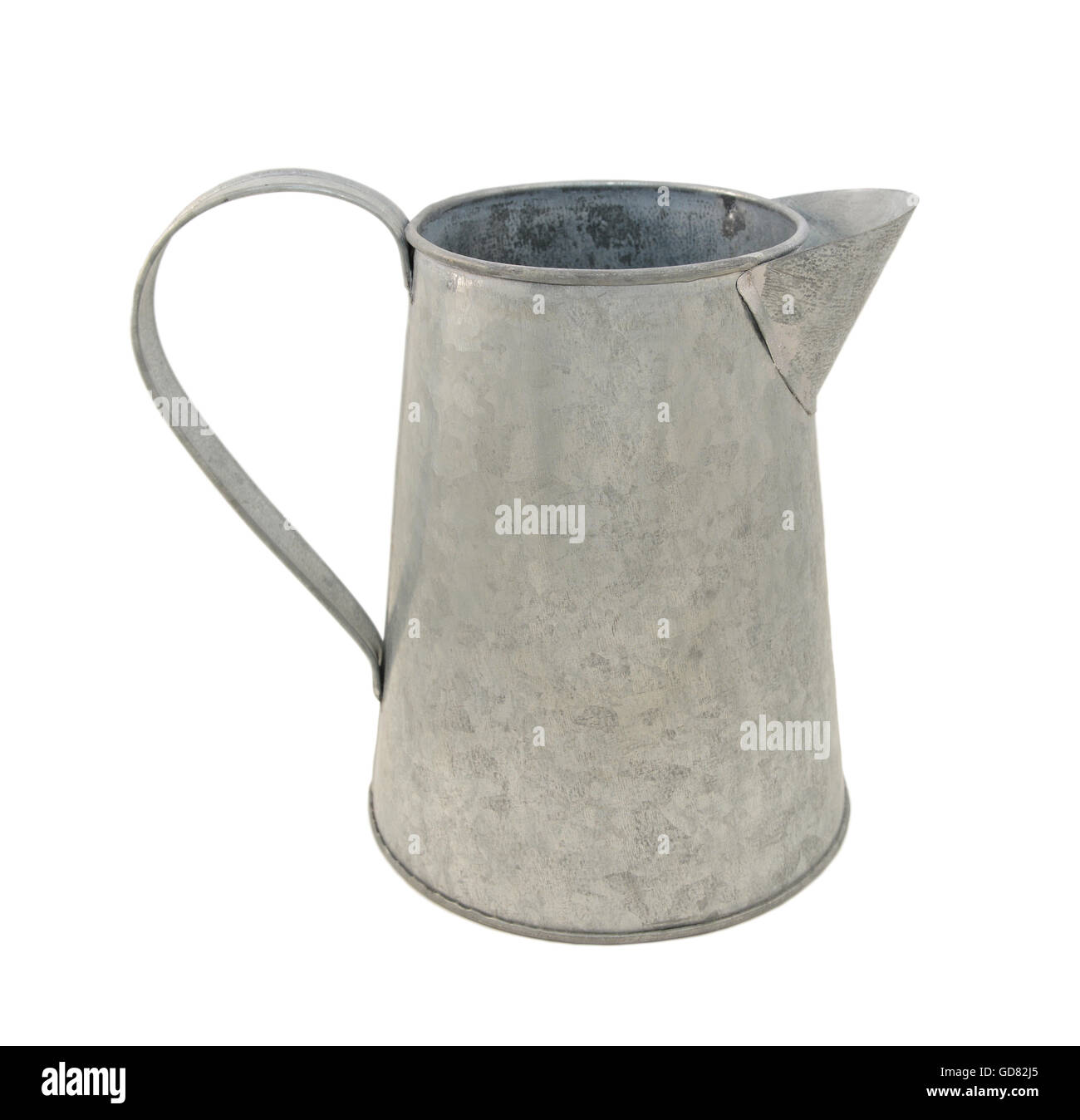 Empty metal pitcher, isolated on a white background Stock Photo