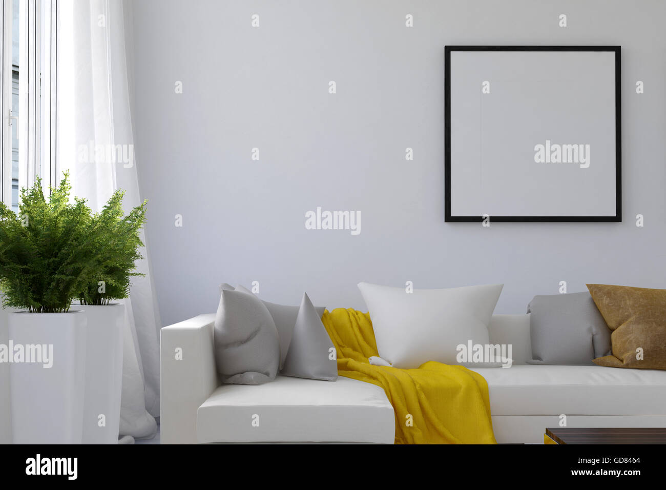 Alamy & Living room scene with blank picture frame and long white sofa with ...