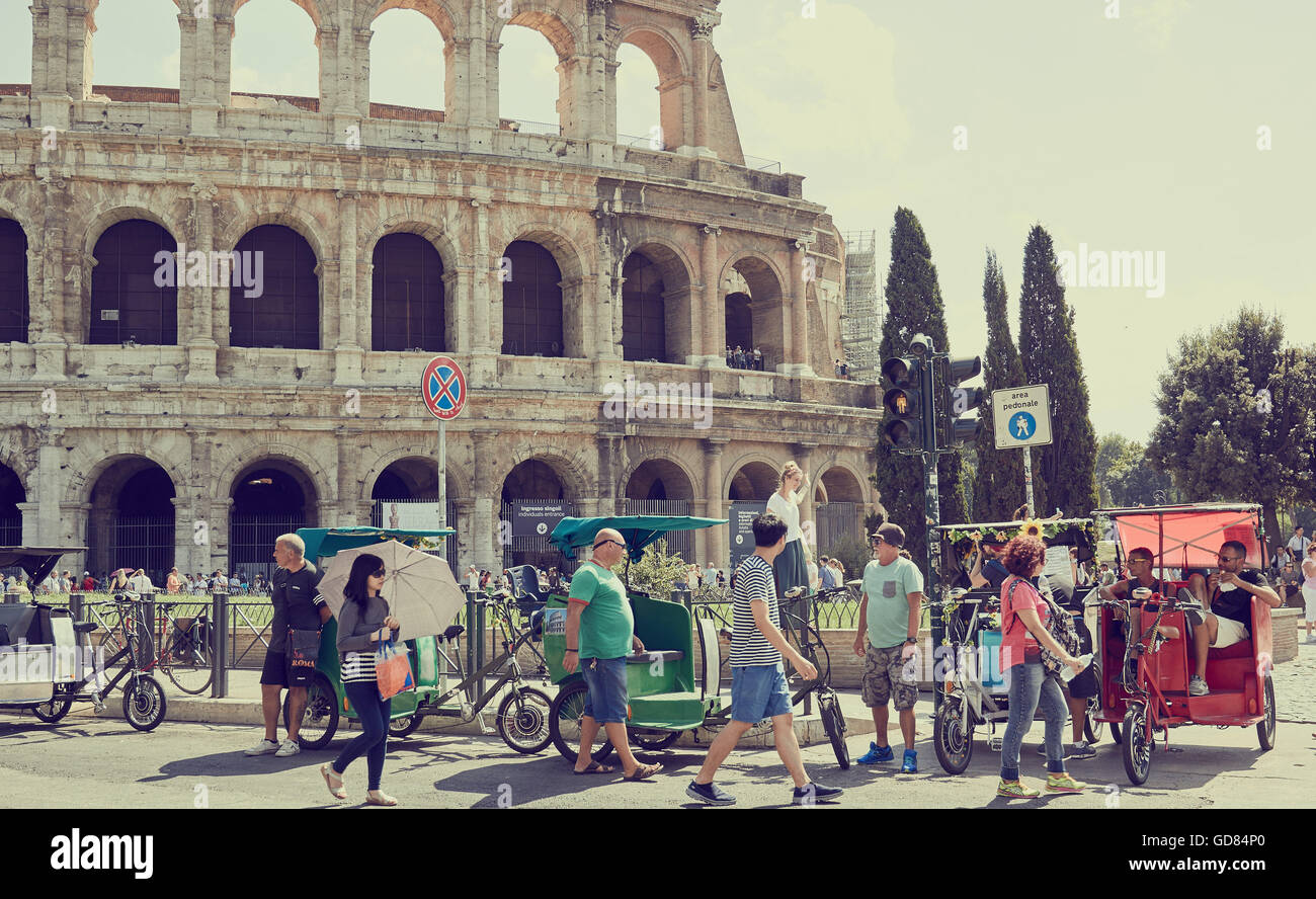 Rickshaws and tourists in front of the Colosseum Rome Lazio Italy Europe - Stock Image
