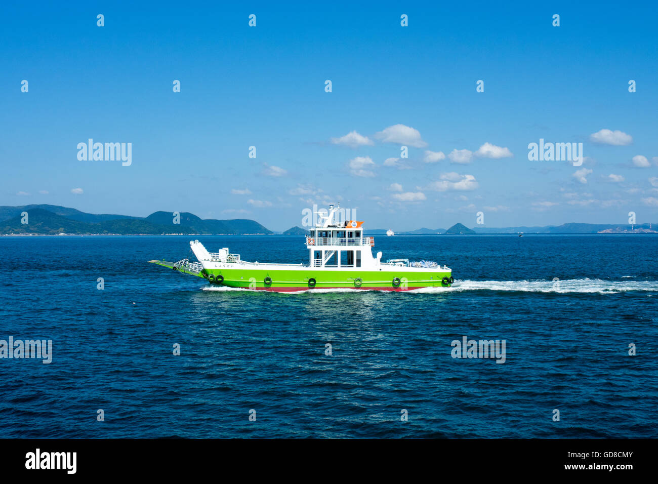 A small transport ferry crossing the Seto Inland Sea. - Stock Image