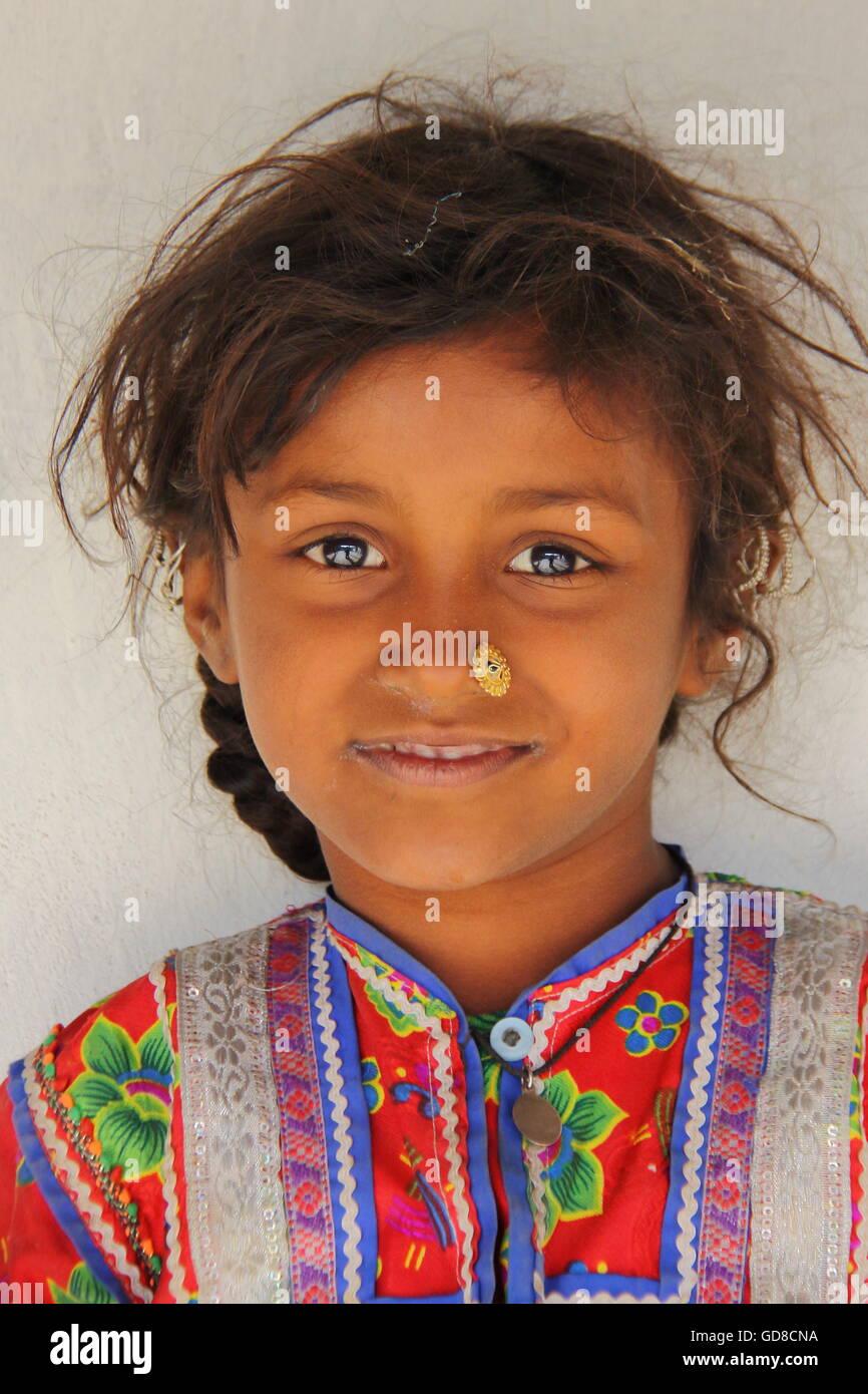 Portrait of a cute and colourful little girl in Hodka, local village near Bhuj, Gujarat, India Stock Photo
