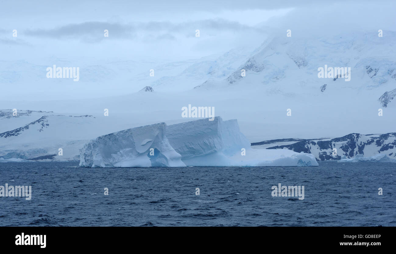 A small iceberg off the coast of   Coronation Island. Coronation Island, South Orkney Islands, Antarctica. - Stock Image
