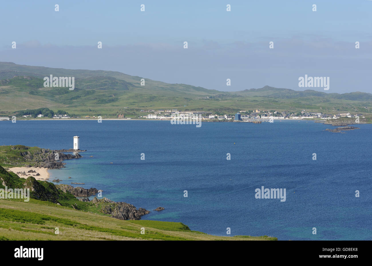 The Lighthouse at Carraig Fhada, Kilnaughton Bay and the town of Port Ellen, Port Eilein, Islay, Inner Hebrides, - Stock Image