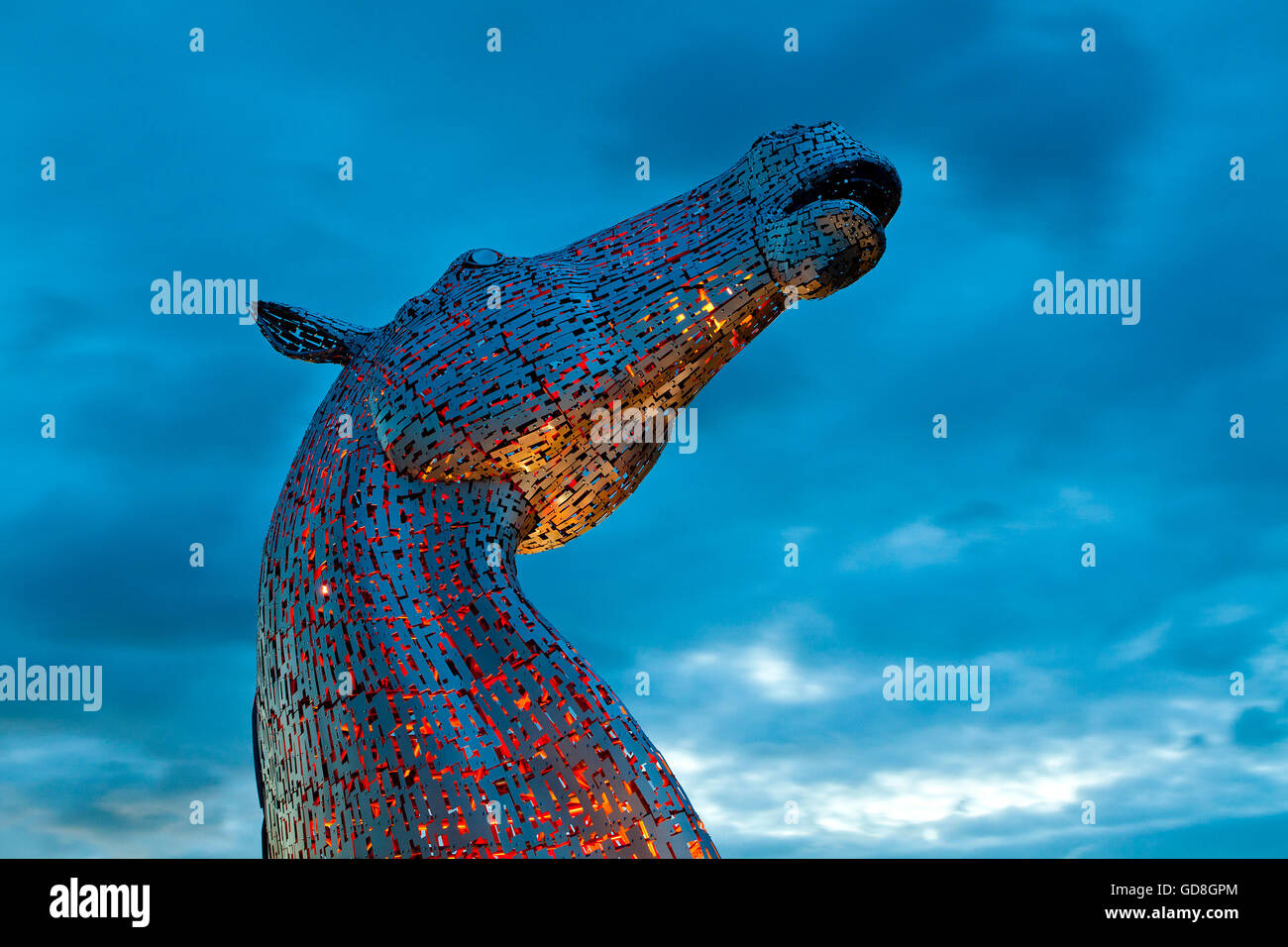 Stormy Kelpie. A night shot of the amazing Kelpie designed by Andy Scott with a dramatic summer sky. - Stock Image