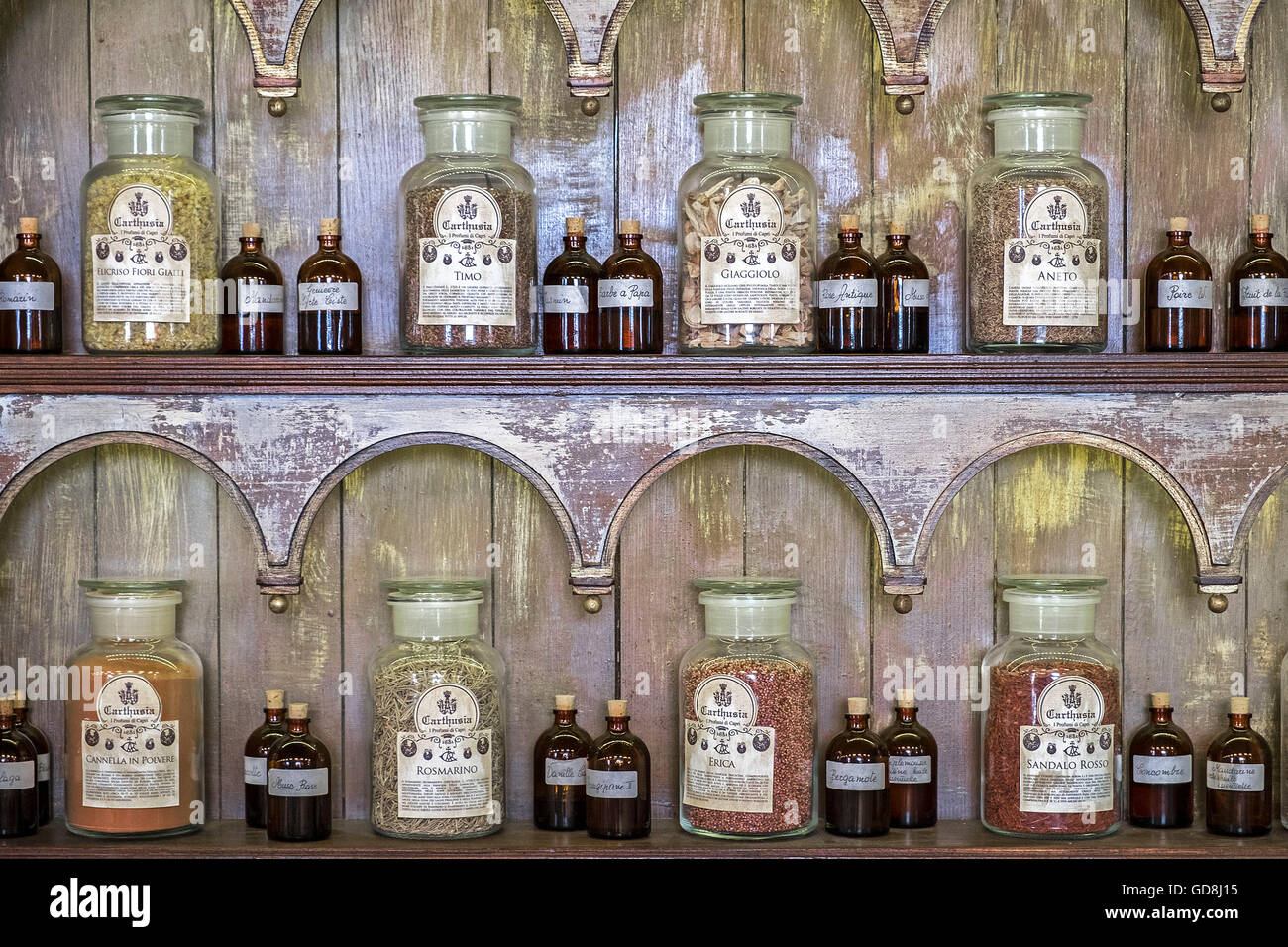 Antique bottles and jars of perfume ingredients at the Carthusia perfumery on the island of Capri, Italy - Stock Image