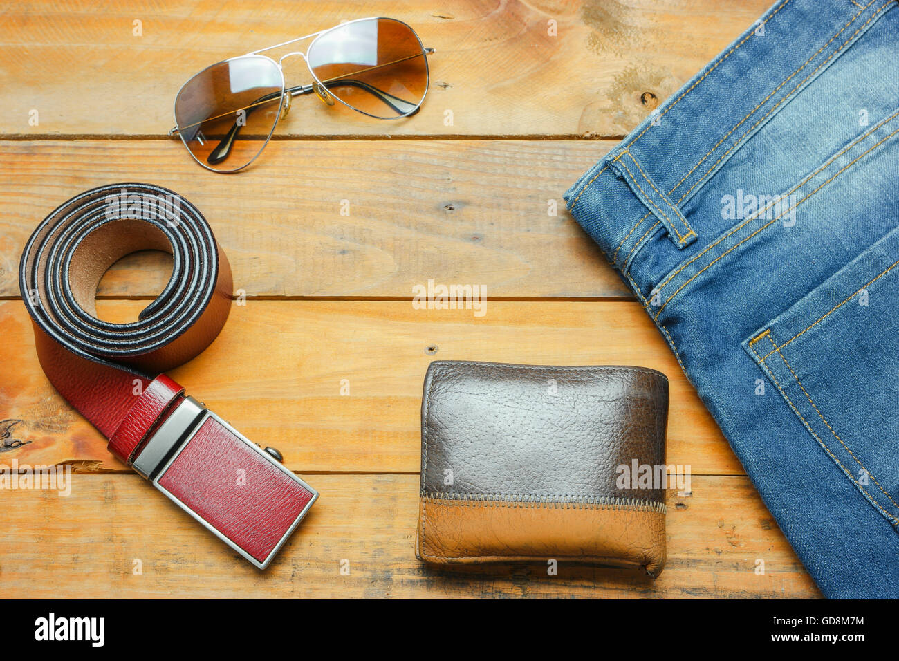 Jeans, sunglasses and leather belt Wallet on the wooden vintage with copy space Stock Photo