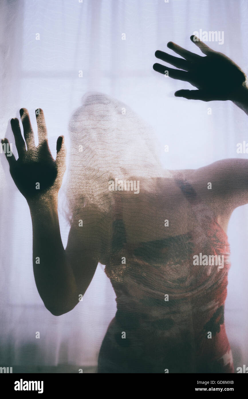 Trapped woman in distress Stock Photo