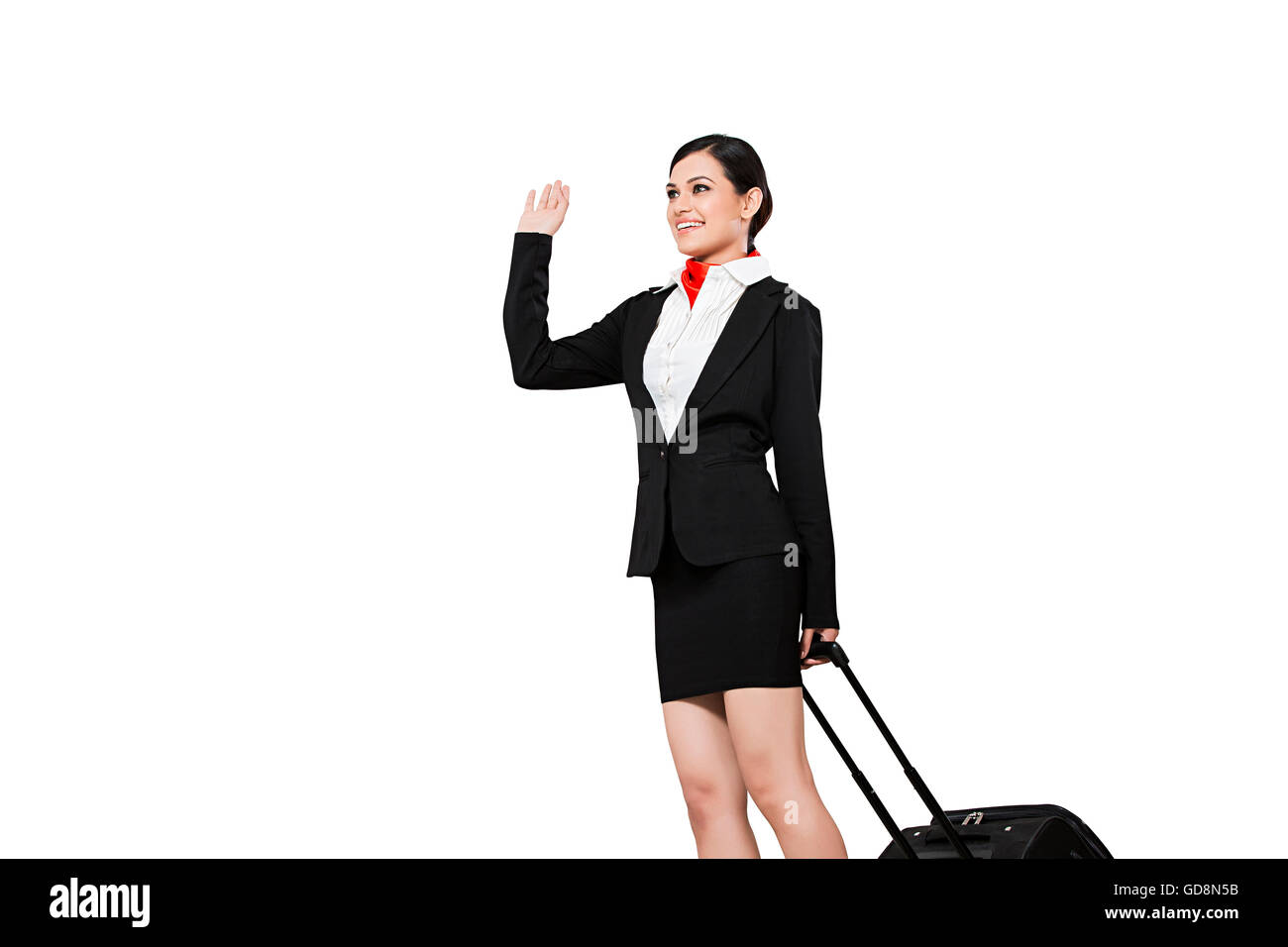1 Indian Adult Woman Air Hostess holding Suitcase standing Waving Hands - Stock Image