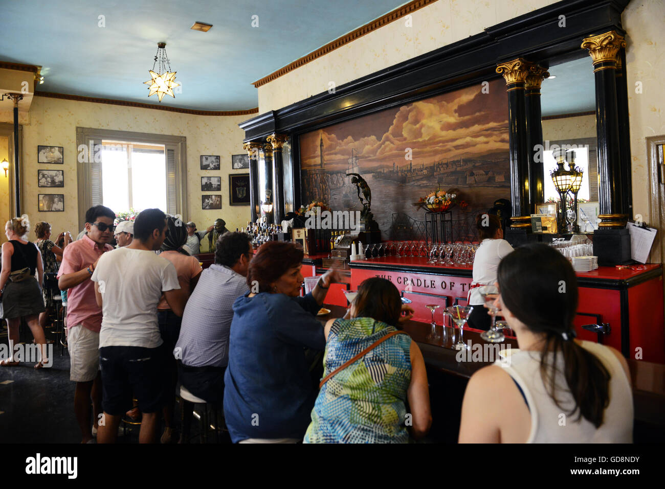 Tourist and locals having a good time in the Floridita cocktail bar. - Stock Image