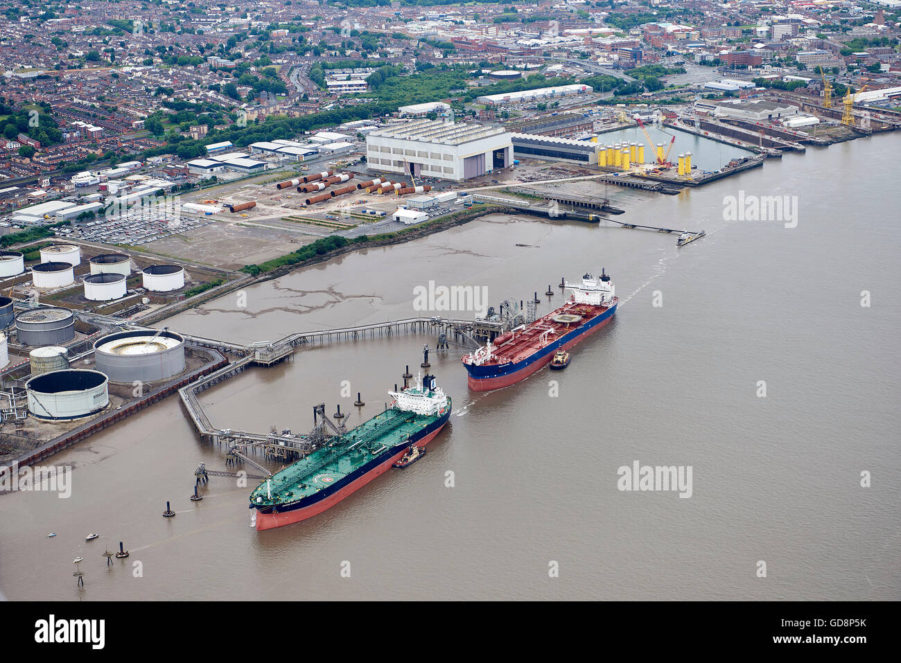 Oil tankers berthed on the side of the river Mersey, Birkenhead, North West England - Stock Image