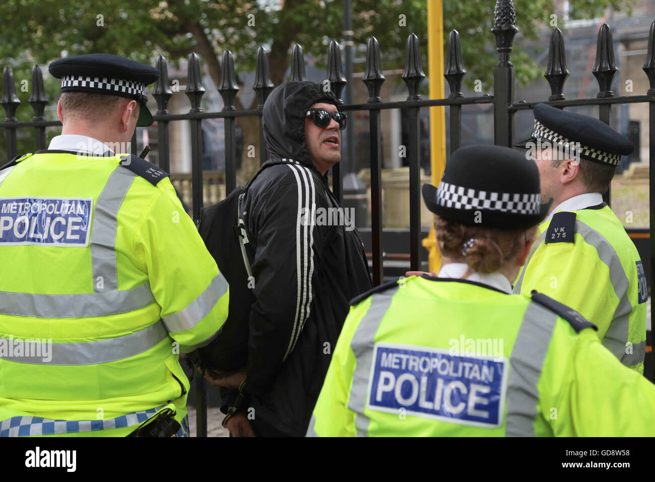 London, UK. 13th July, 2016. Police temporally detain a anti fascist after clashes with Brexit supporters as Brexiters Stock Photo