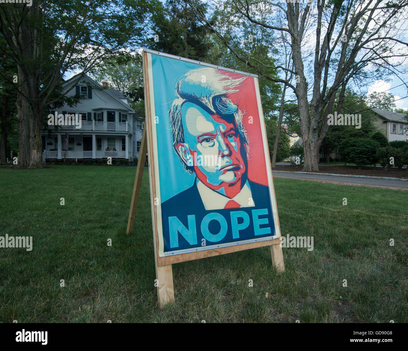 Lexington, Massachusetts, USA.  13th July, 2016.  A Lexington, MA, democrat made a 3 foot by 5 foot poster protesting - Stock Image