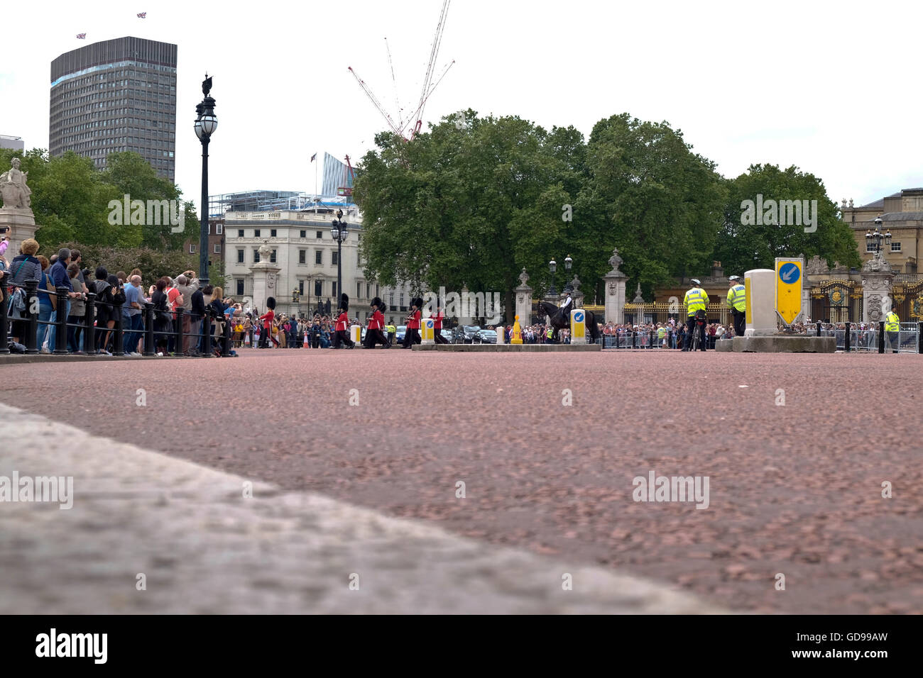 A Road Level View From Victoria Memorial Circle Of Soldiers Marching Off After Changing The Guard At Buckingham Palace