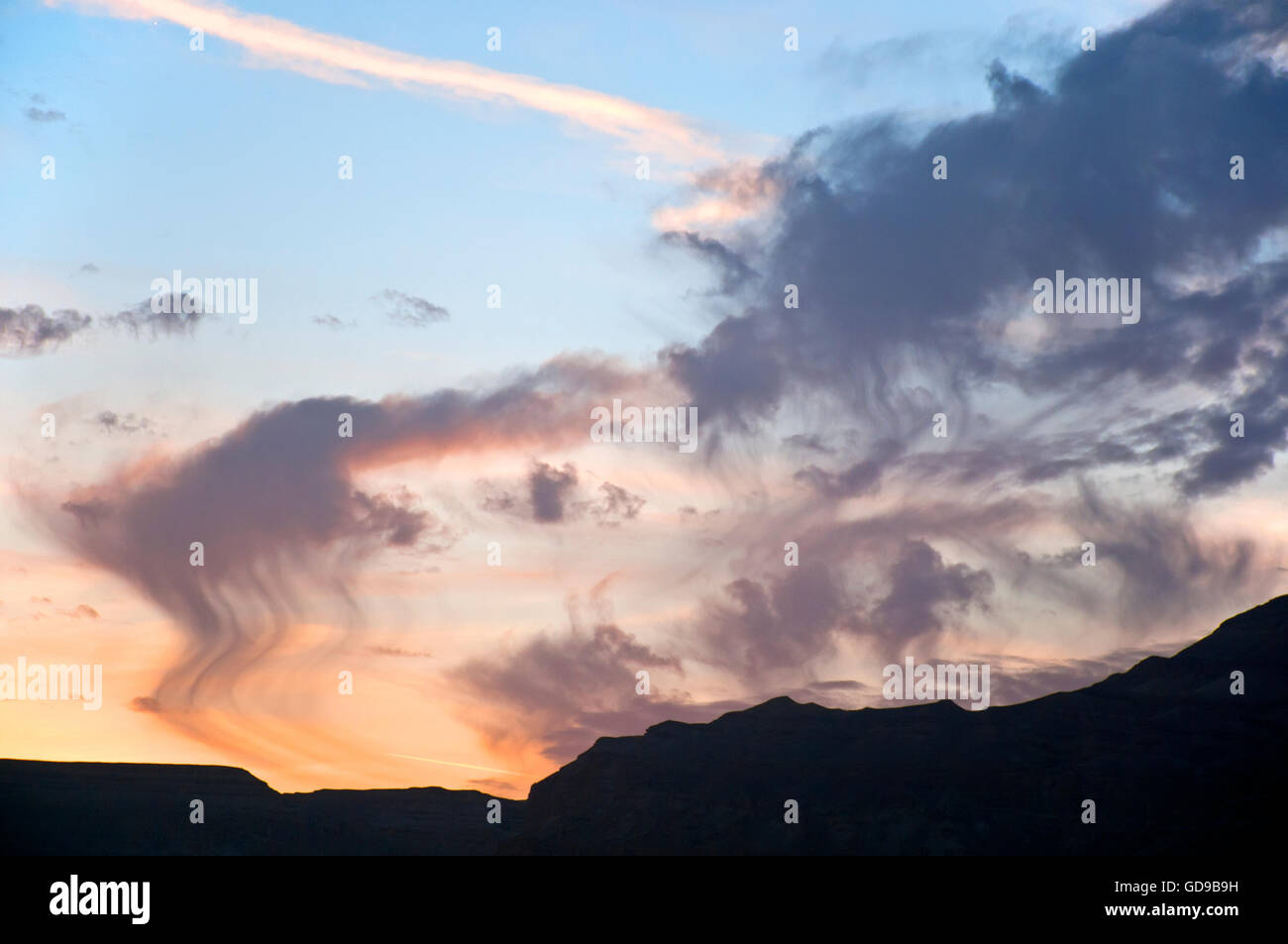Unique sunset clouds over desert - Stock Image