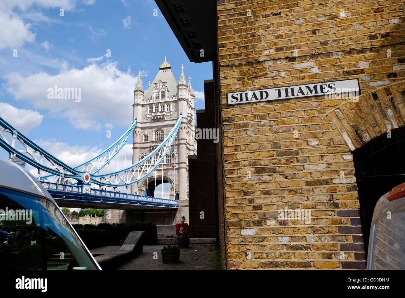 Shad Thames is a historic riverside street next to Tower Bridge in Bermondsey, London, England Tower Bridge in the - Stock Image