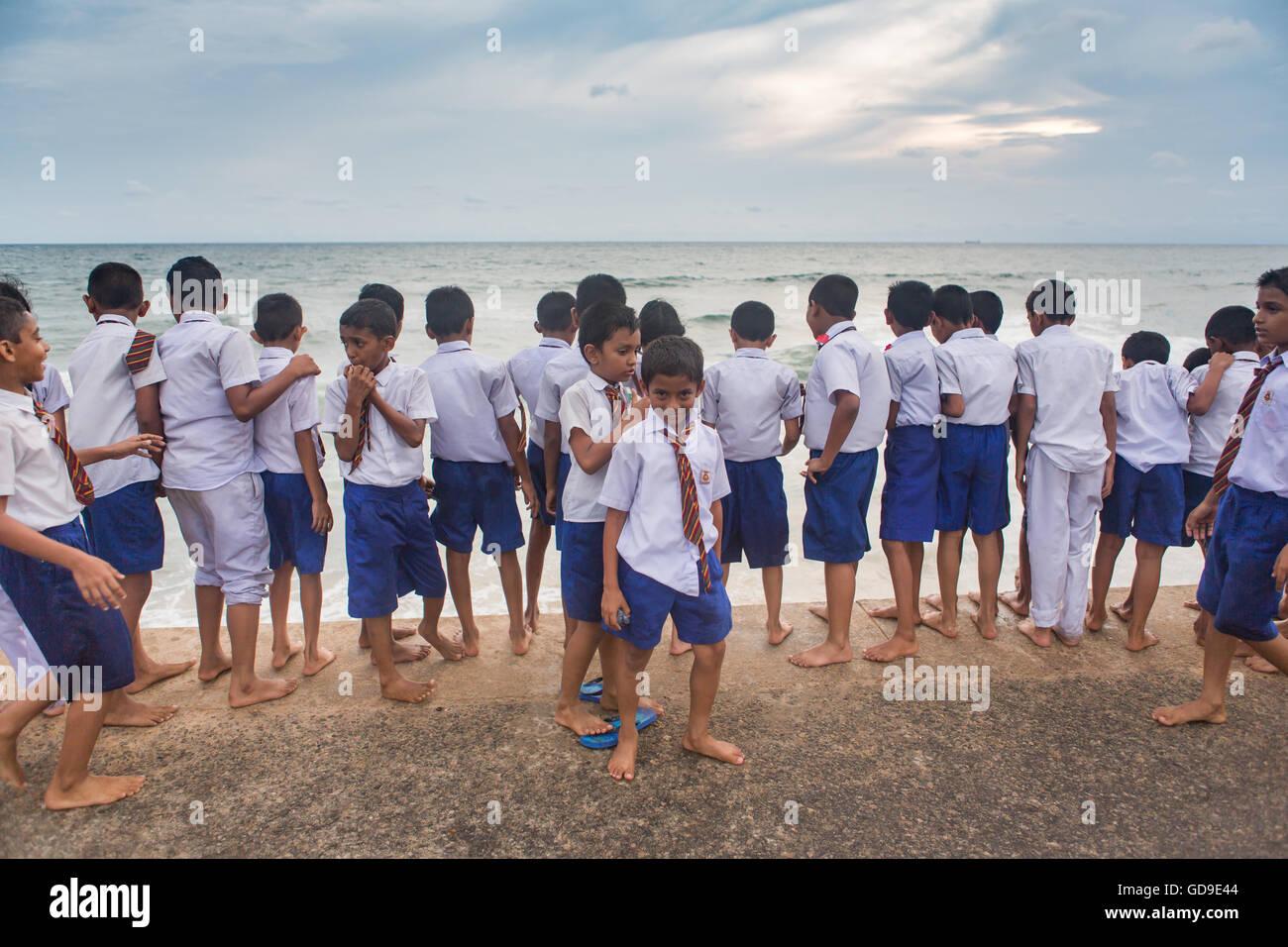 schoolchildren on the promenade at Galle Face Green, Sri Lanka - Stock Image