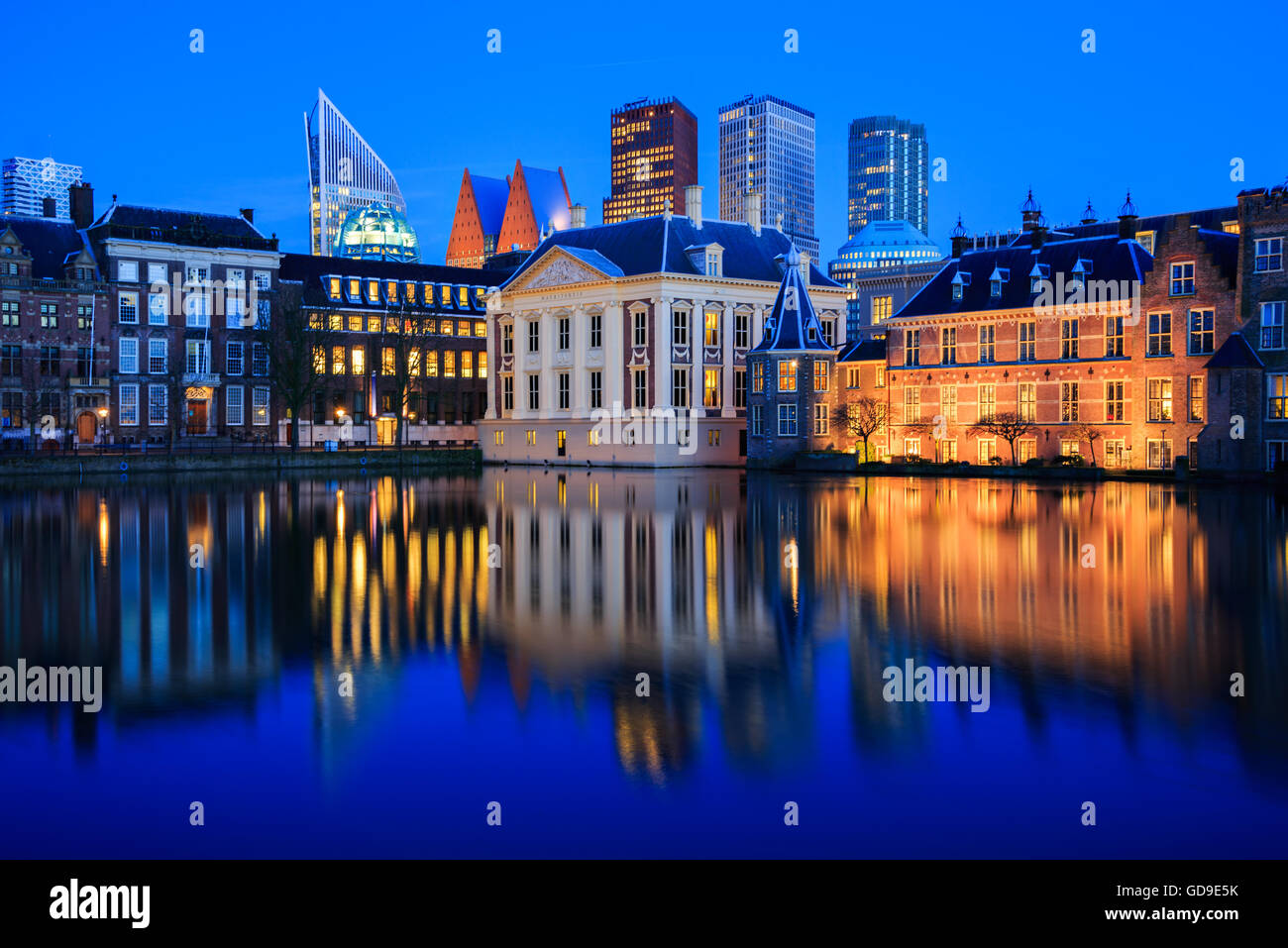 Skyline of The Hague with the modern office buildings behind the historic Mauritshuis museum at Blue Hour in the - Stock Image