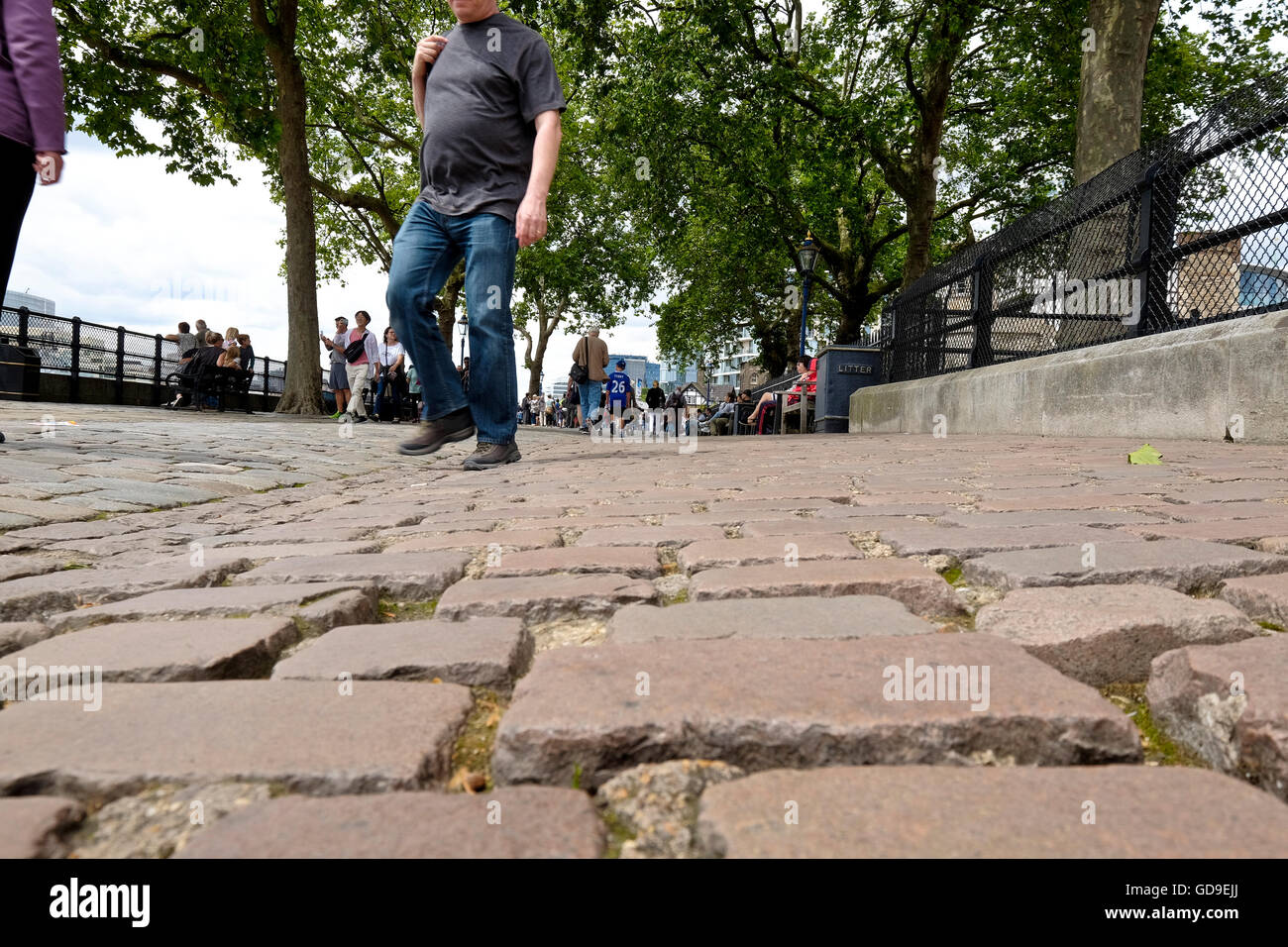 An worms eye view of the paving on Victoria Embankment along the Thames river London. - Stock Image