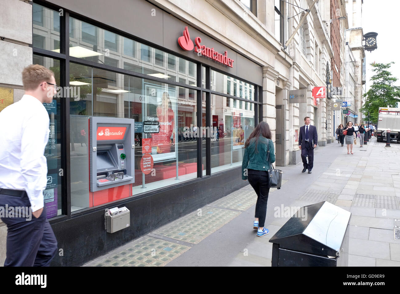 Santander a UK Bank cash point ATM and retail banking outlet in London's CBD - Stock Image