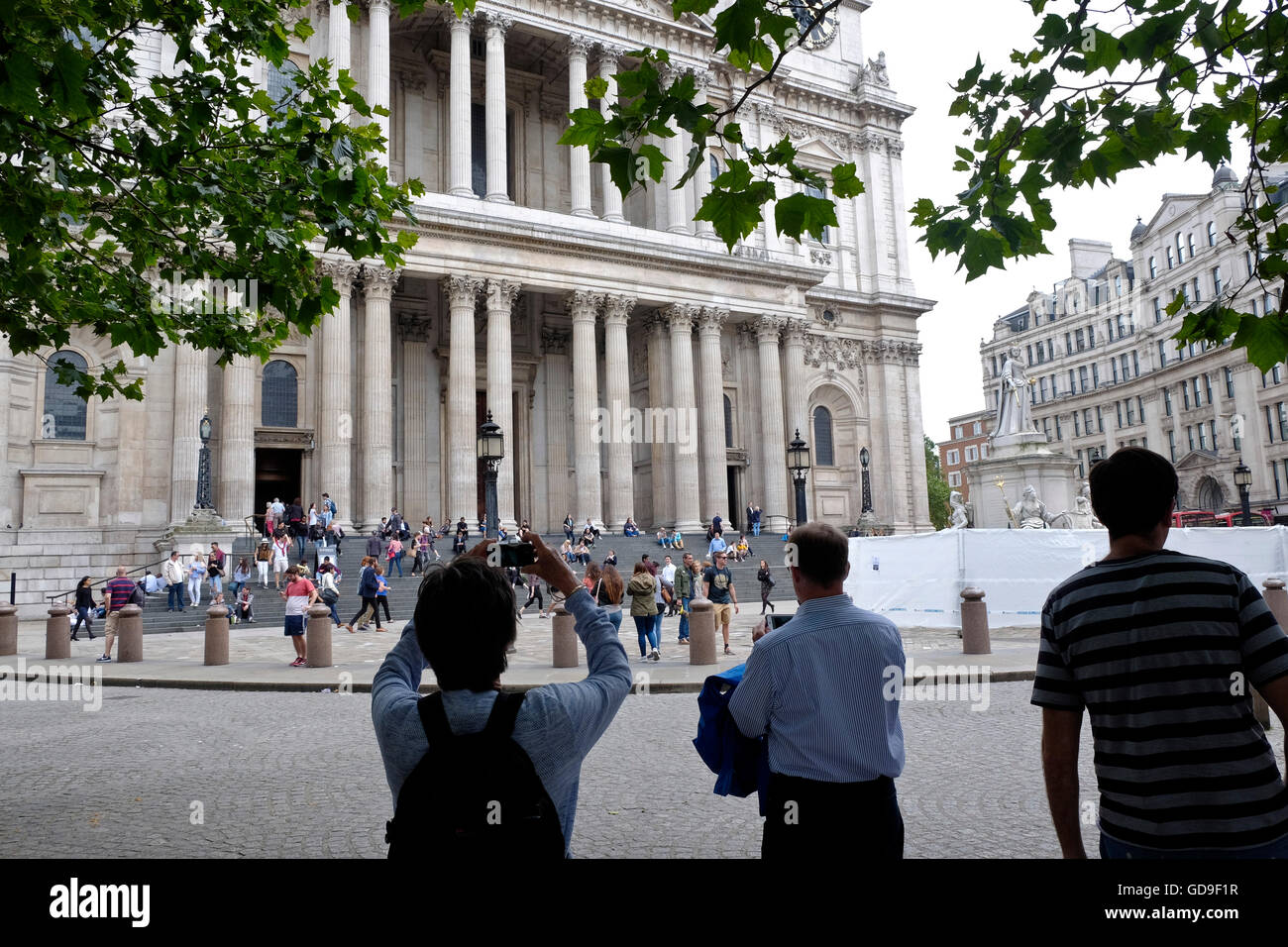 Tourists outside St Paul's Cathedral a London landmark Stock Photo