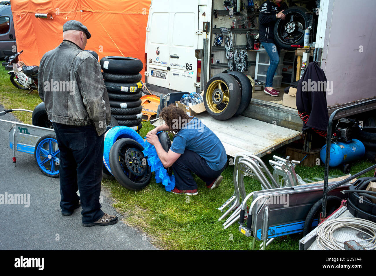 Tyres being prepared in pits area of grandstand at 2016 TT races - Stock Image