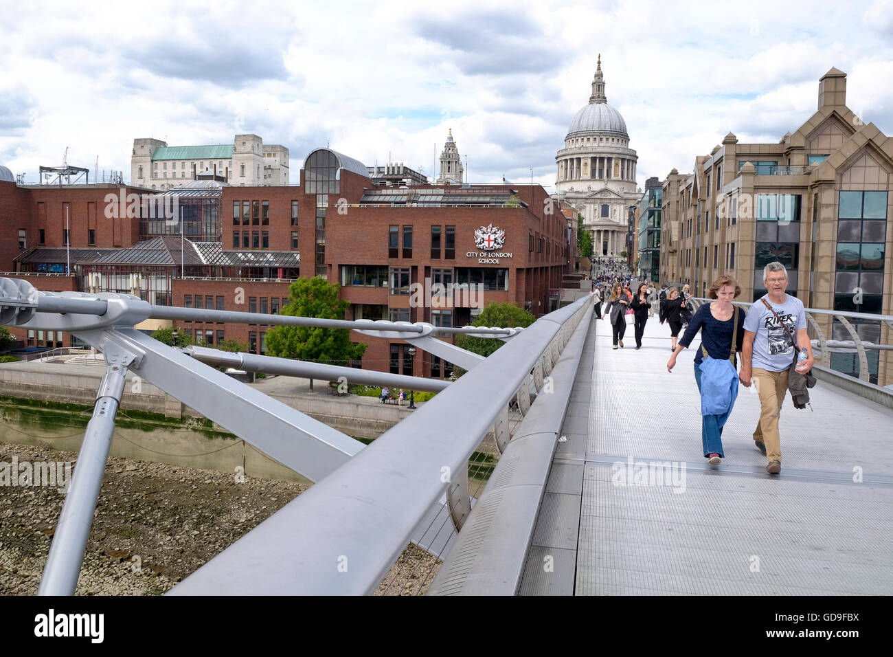 London, United Kingdom. St Paul's cathedral a London landmark from the Millennium Bridge which crosses the Thames - Stock Image