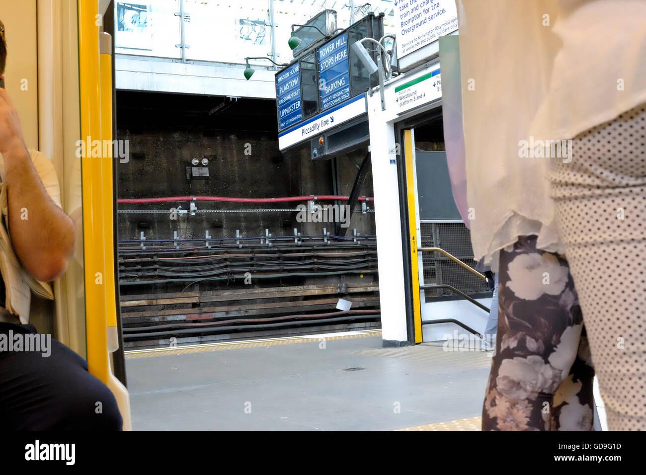 Underground station cabling through open train door. - Stock Image