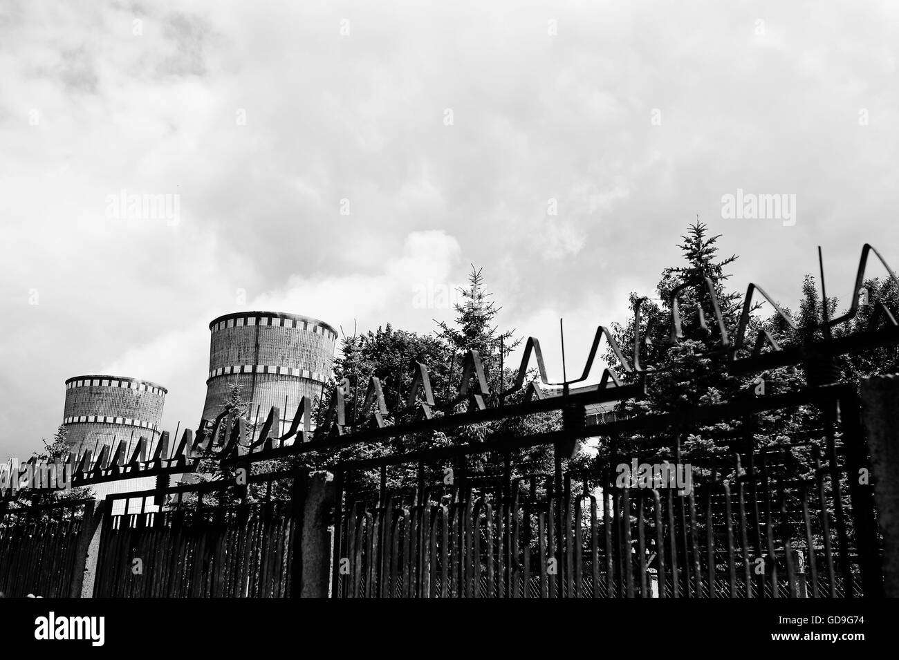 Nuclear power station. Tops of cooling towers of atomic power plant - Stock Image