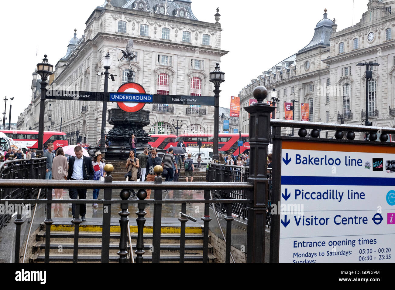 Piccadilly Circus London. Steps from the Piccadilly Circus underground station lead up Piccadilly Square Stock Photo