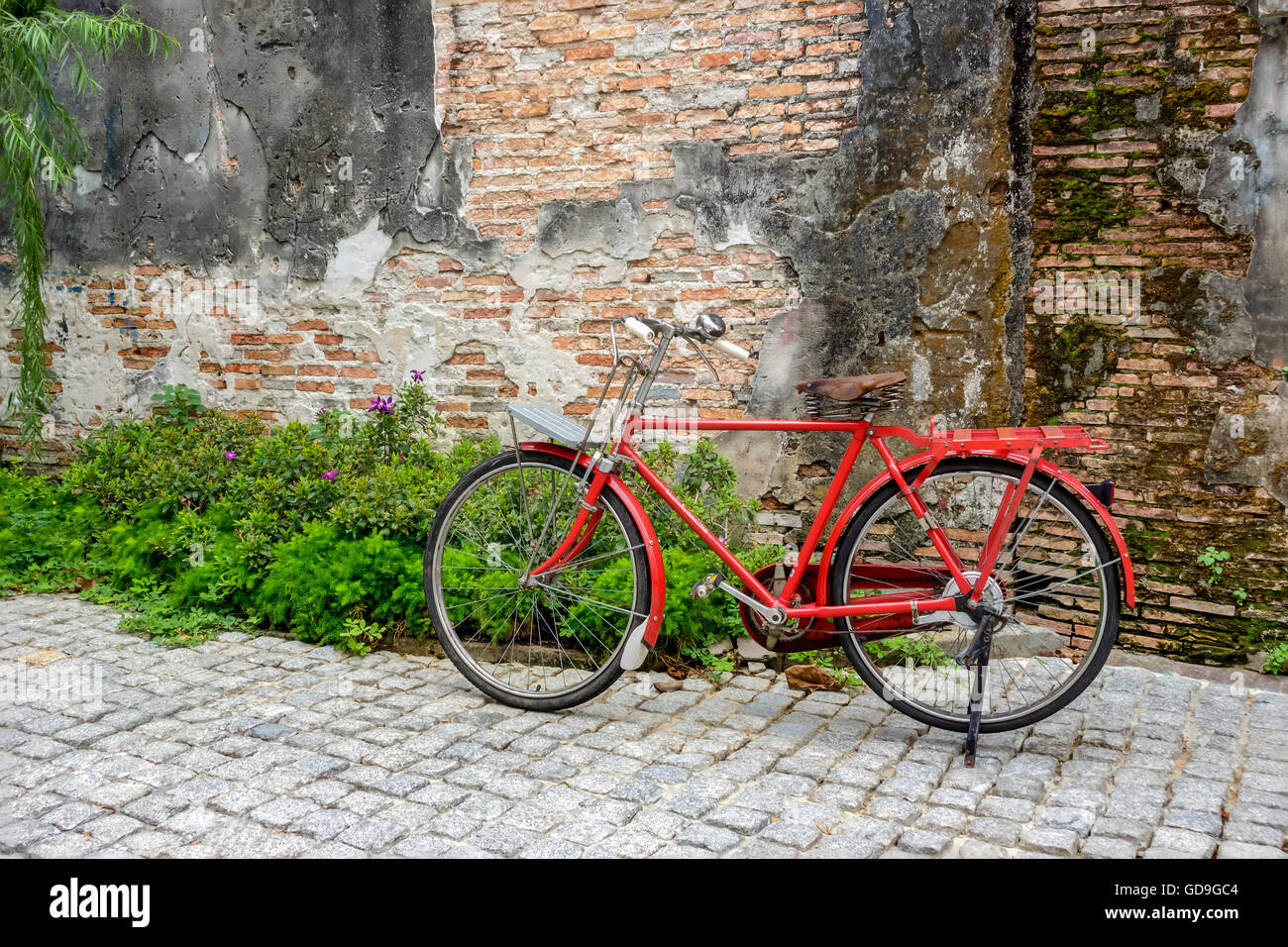 Retro styled image of a vintage red bicycle - Stock Image