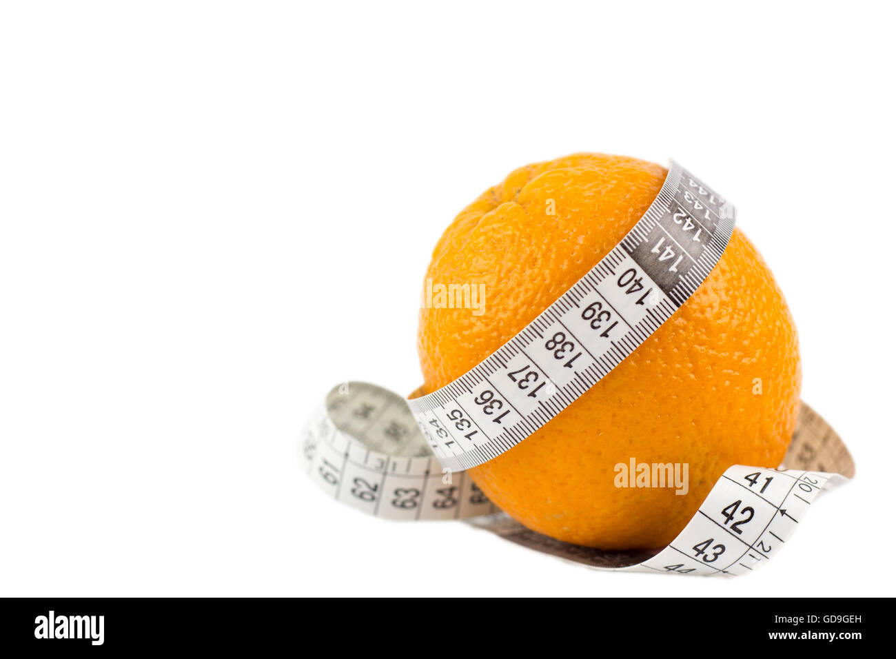 Orange with measuring tape isolated over white background - Stock Image