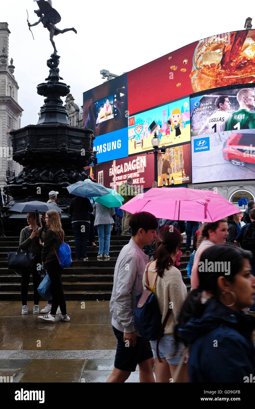 London Piccadilly Circus.The bright neon lights of the advertising displays back lighting Eros in Piccadilly Circus - Stock Image