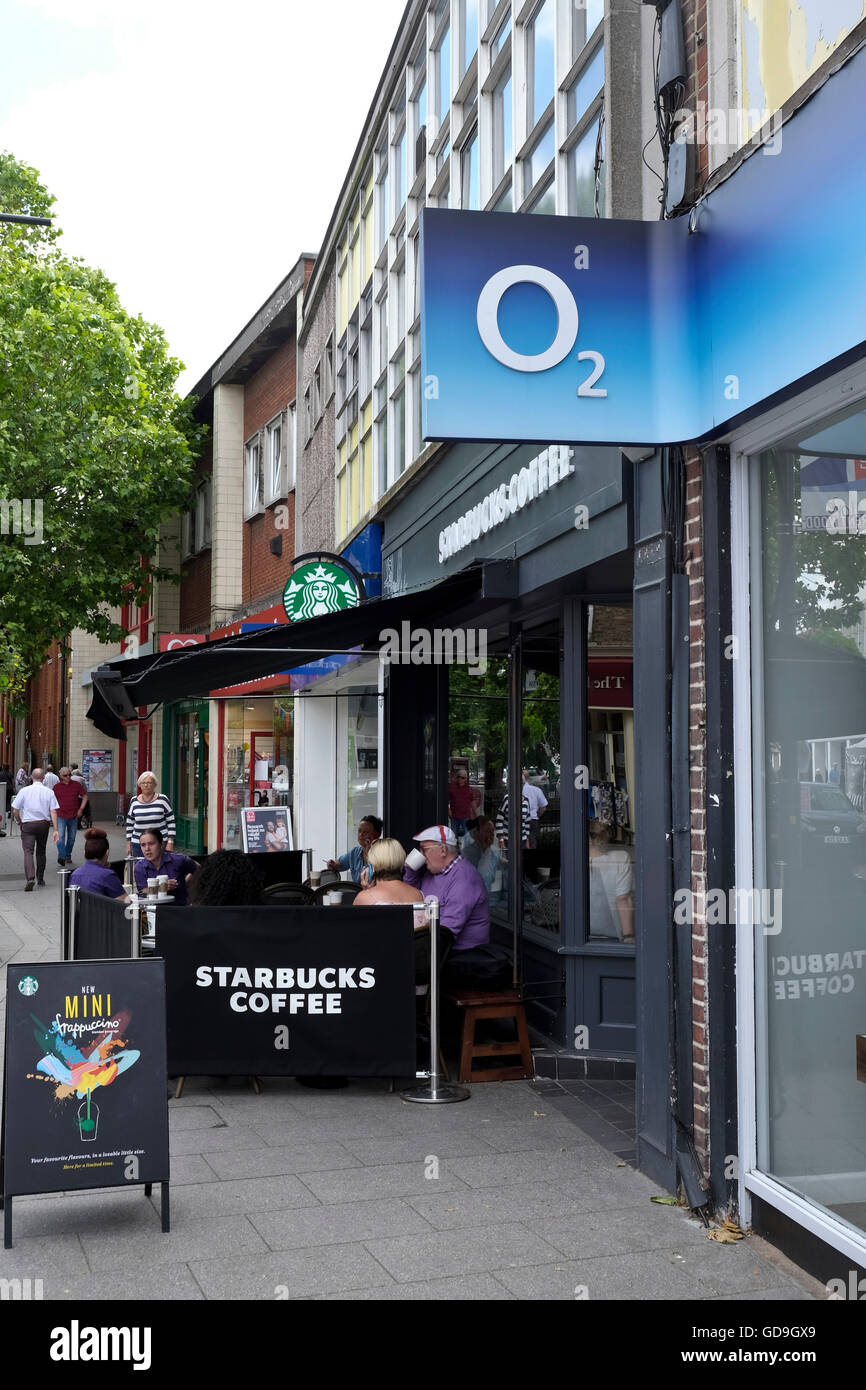 Brentwood UK. A typical High Street in a Village in Brentwood Essex England with O2 and Starbucks retail outlets - Stock Image