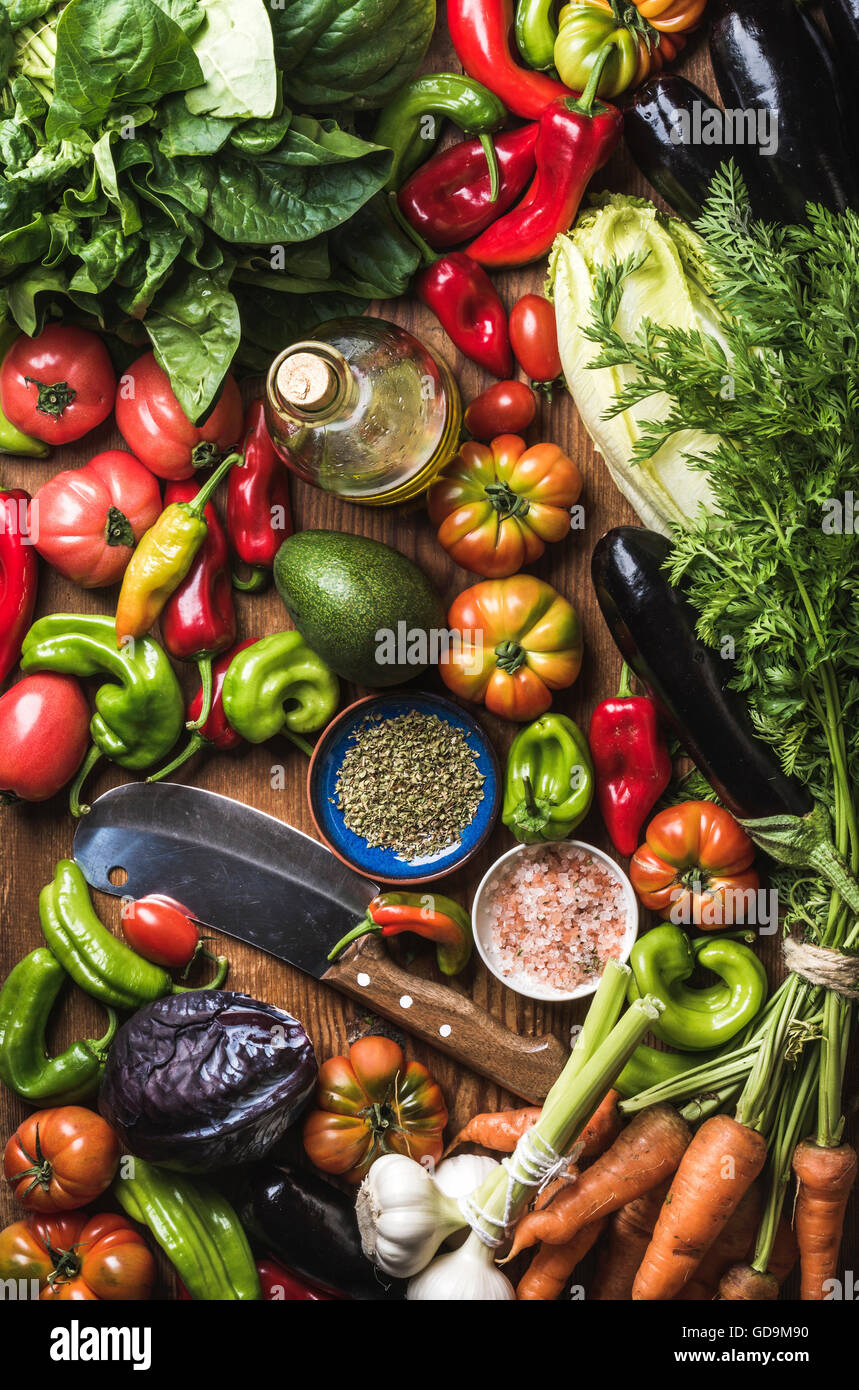 Variety of fresh raw vegetables for healthy cooking or salad making and carving knife, top view. Diet or vegetarian - Stock Image