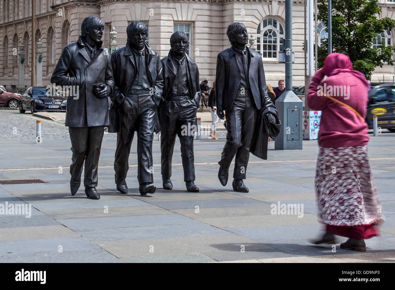 The Fabulous Four Beatles statues on the coastal riverside promenade on Liverpool's Waterfront, Merseyside, UK. - Stock Image