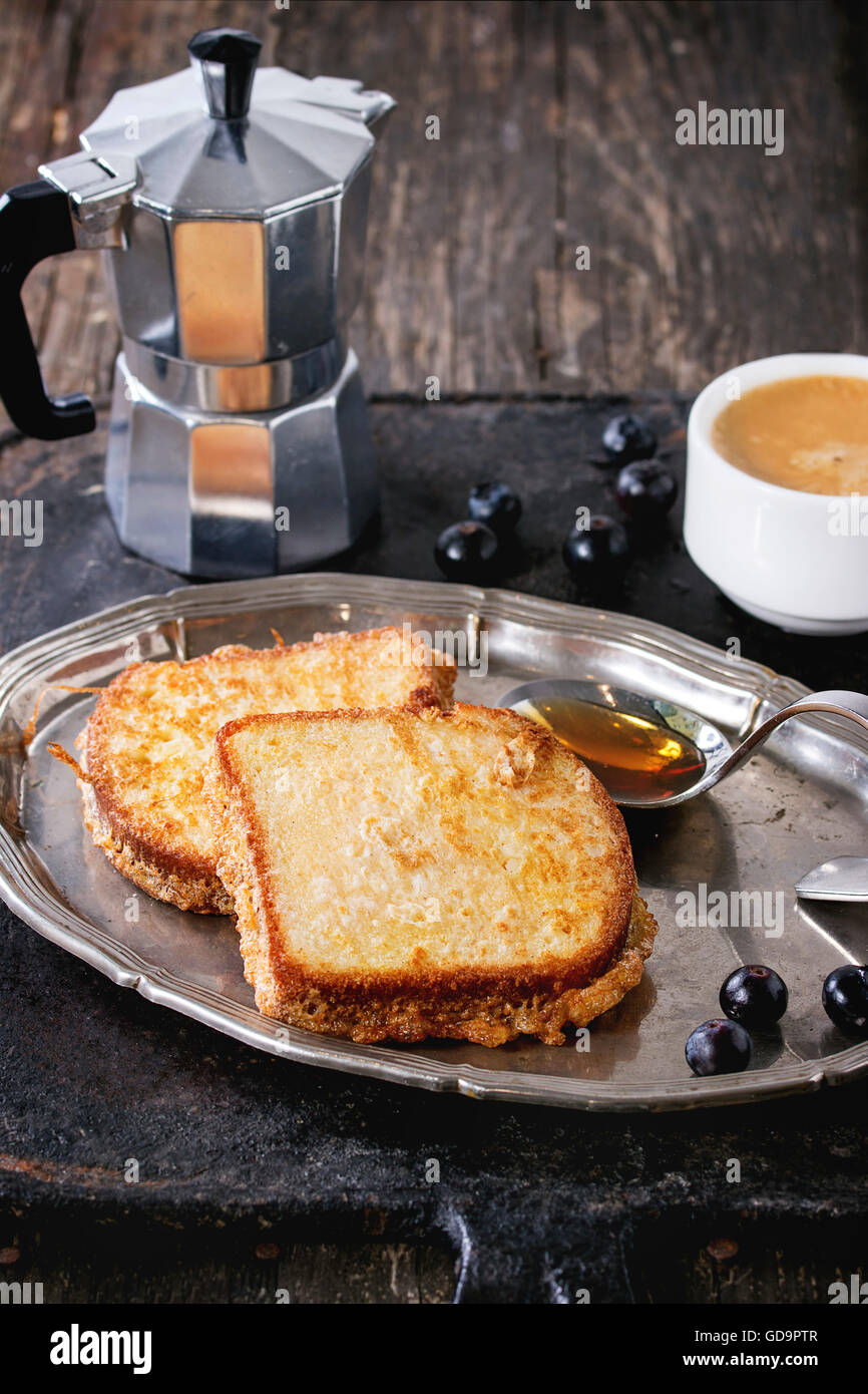 Breakfast theme. Grilled Toasts with honey, blueberries, cup of coffee espresso and coffee pot, served on vintage - Stock Image