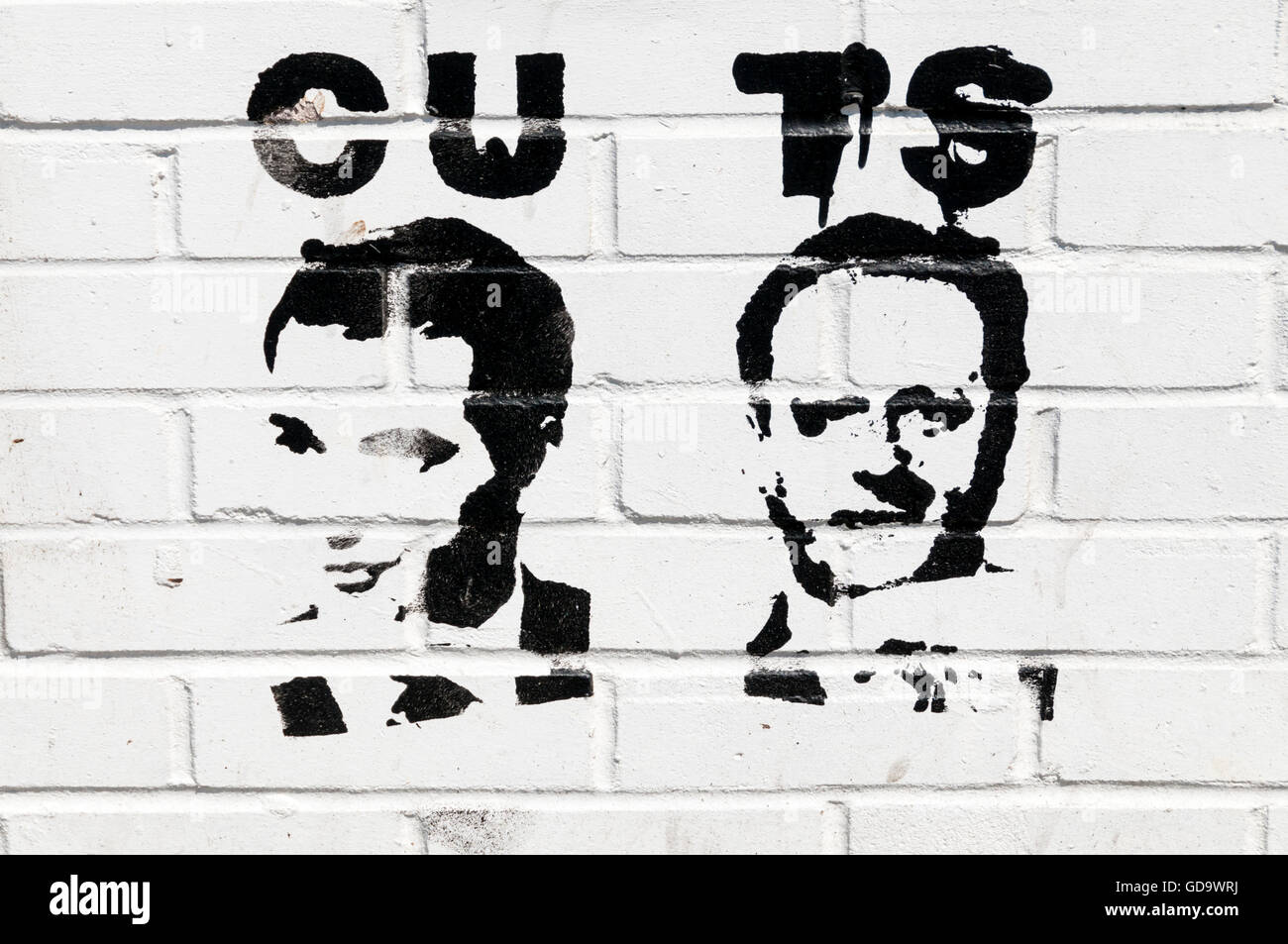 Anti-austerity political graffiti in Margate - portraits of George Osborne and David Cameron and the word Cuts creatively - Stock Image