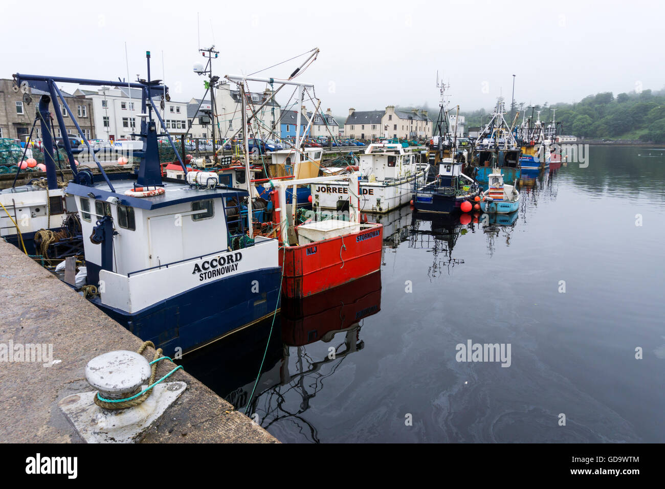 Scottish fishing boats moored in Stornoway Harbour on the Isle of Lewis in the Outer Hebrides. - Stock Image