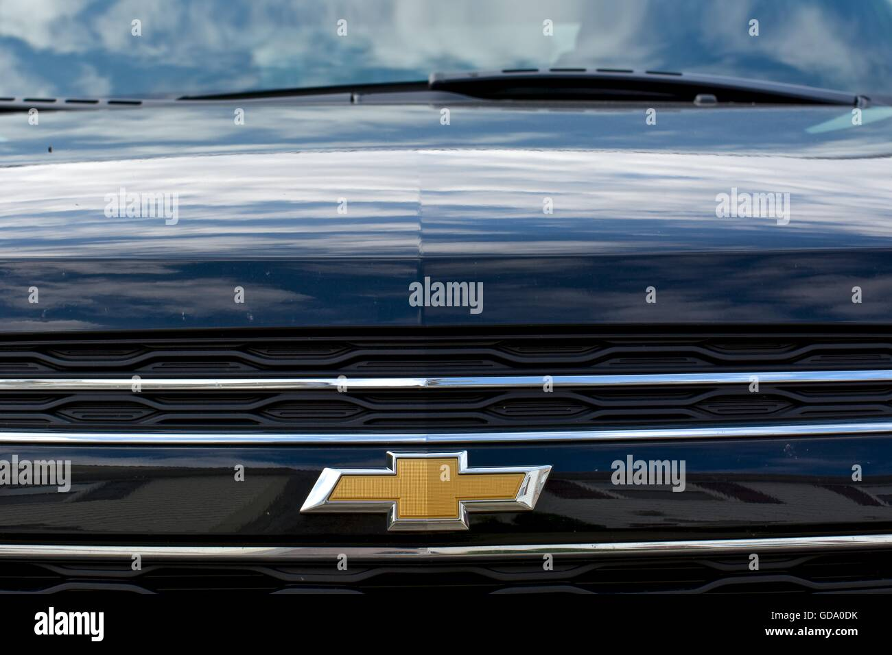 All Chevy black chevy symbol : The front end of a black Chevy vehicle showing the Chevy symbol up ...