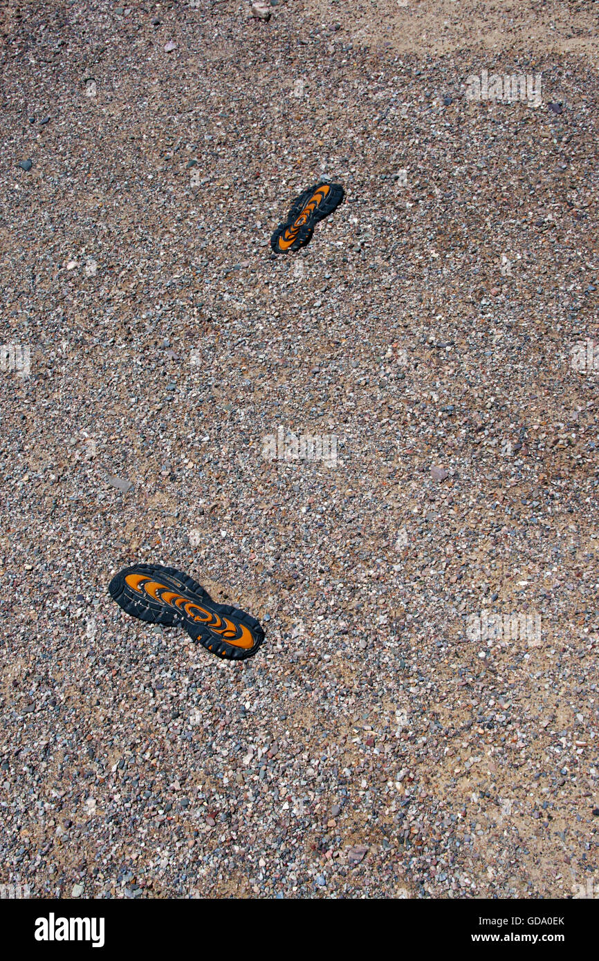 Soles of Shoes found in Sand - Stock Image