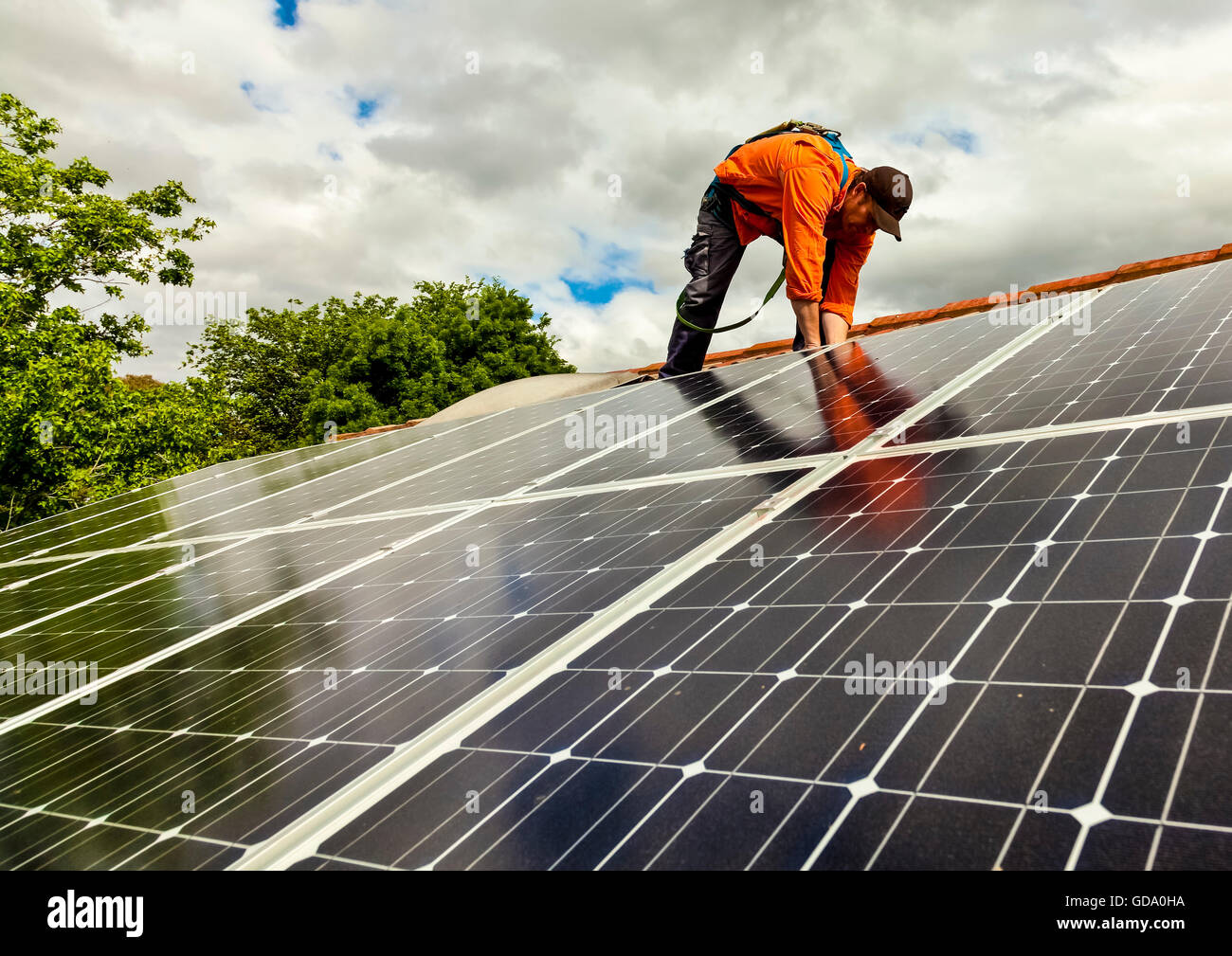 Electrician checking solar panels - Stock Image