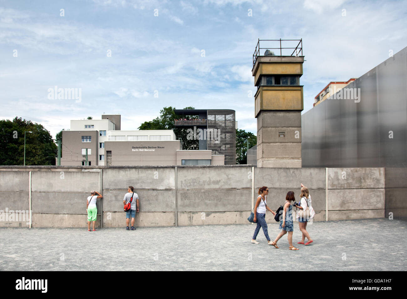Berlin Wall from the east at Bernauer Strasse with watchtower in death strip in Berlin Germany - Stock Image