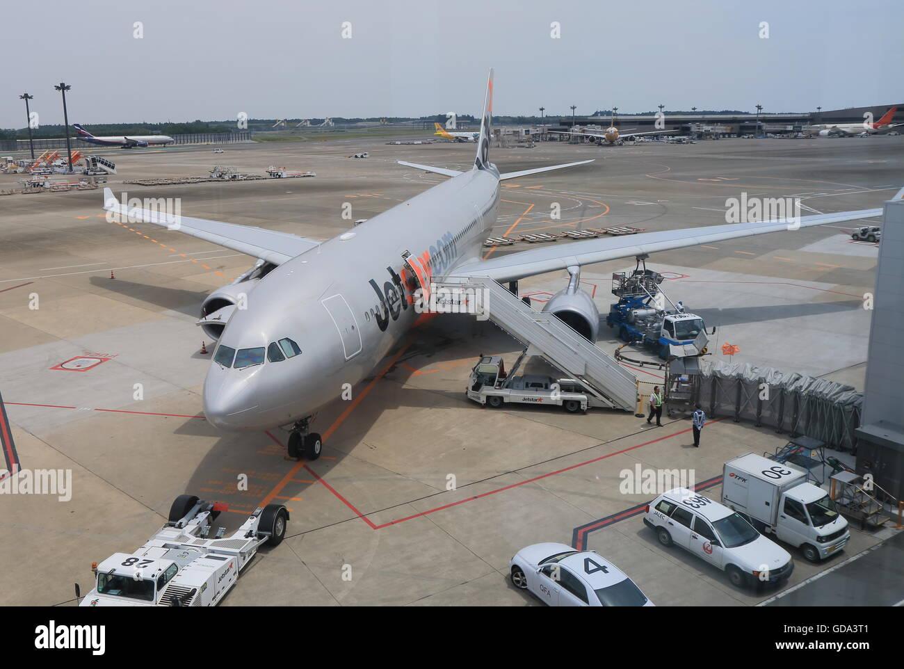Jetstar airplane prepares for departure at Narita airport in Tokyo Japan. - Stock Image
