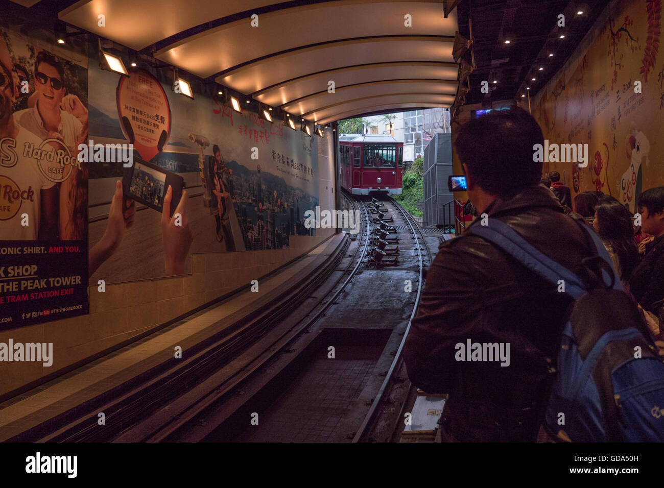 The Peak Tram approaching the lower station, Hong Kong, China. - Stock Image